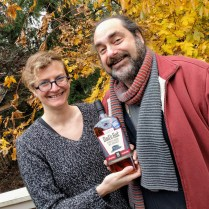 """Andy and I """"raced"""" to finish our revisions and he won this bottle of booze! Best contest ever."""