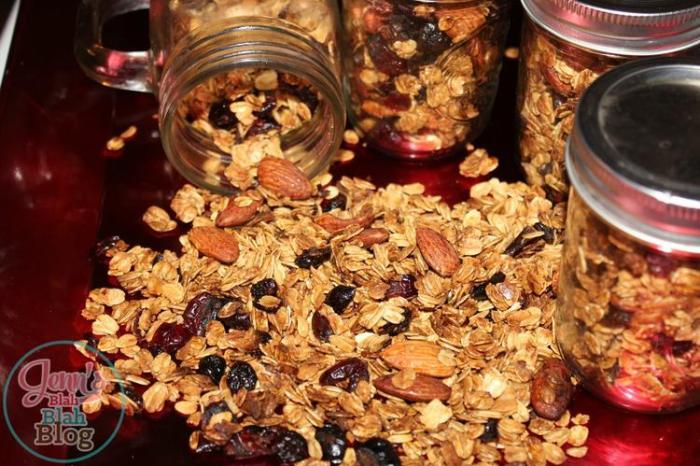 homemade granola in jars laying on table