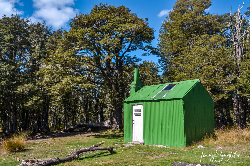 Green and white Bealey Top Hut on the Bealey Spur Track.