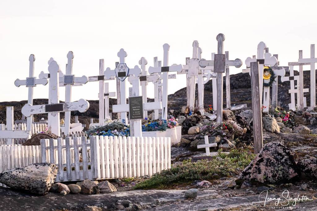 White crosses cluster together in a small cemetery near the start of the Yellow Trail, Ilulissat