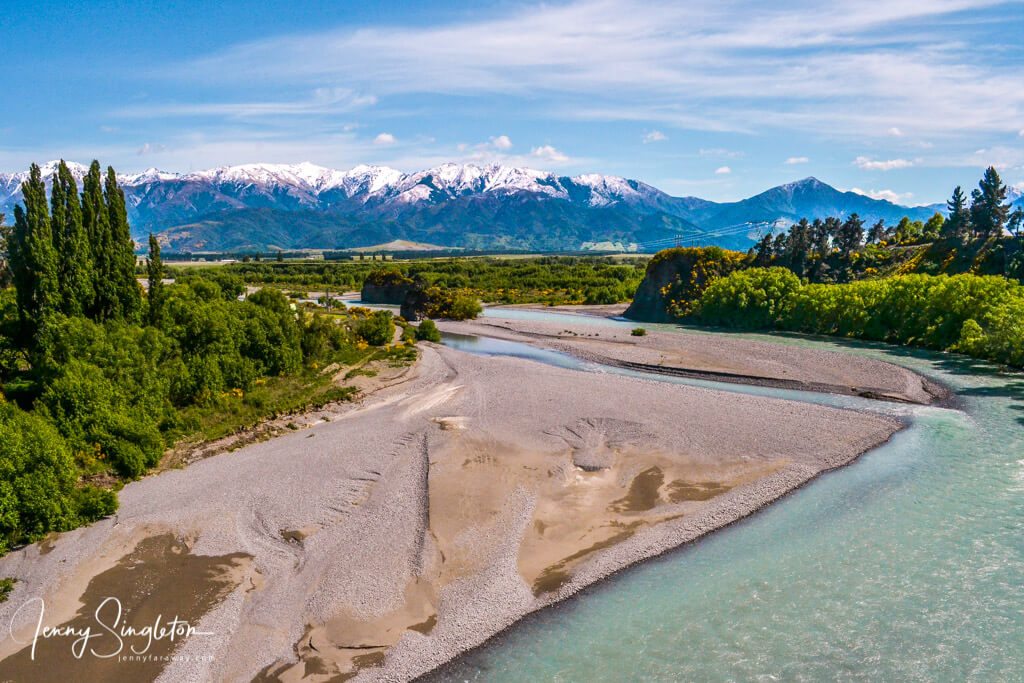 Snow-capped mountains and a clear blue river near Hanmer Springs, New Zealand