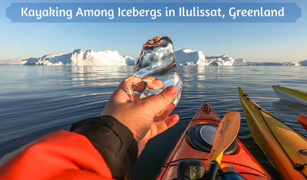 Slider graphic of me holding a chunk of 'black' ice in front of my kayak and huge icebergs.