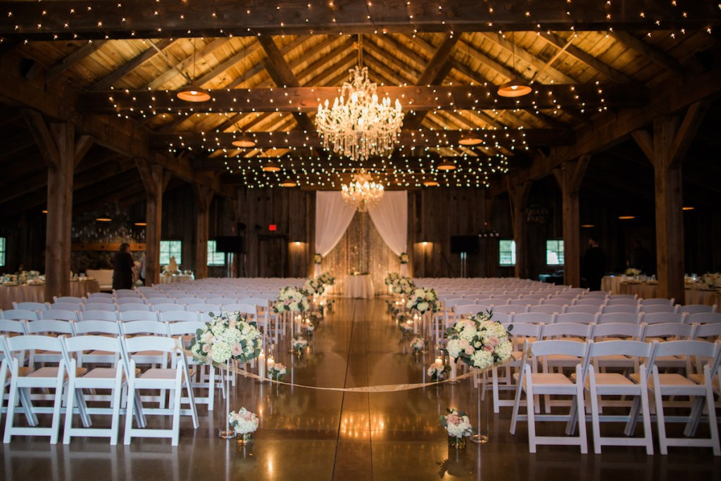 Kelley Farm Indoor Ceremony with Crystal Draping and Flowers.