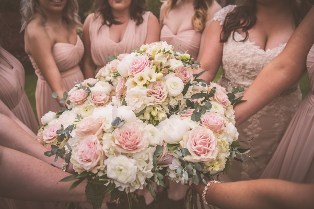 Rose and hydrangea bouquets by Jen's Blossoms.  St. Patrick's Church Wedding