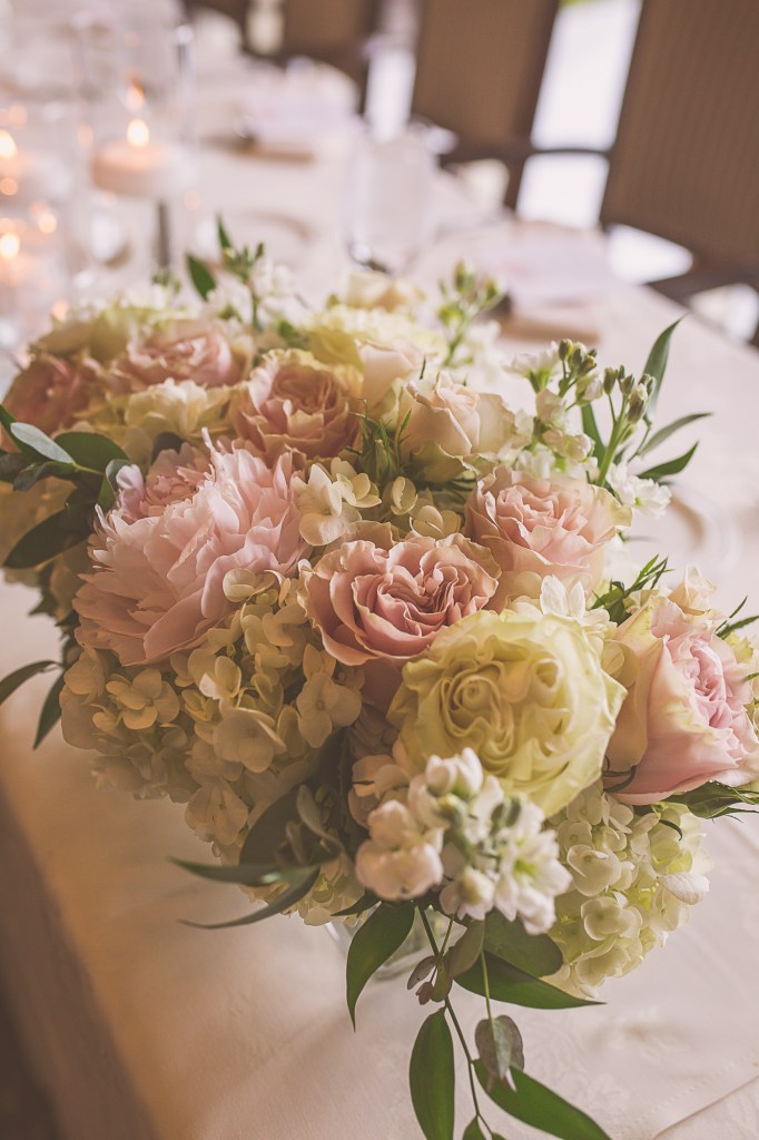 Blush & White head table arrangements by Jen's Blossoms