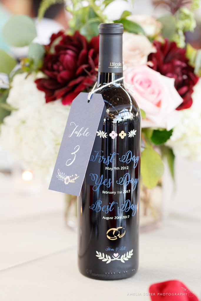 Engraved wine bottle table numbers.  Number tags by Paper Luxe.  Foss Waterway Seaport Tacoma Wedding