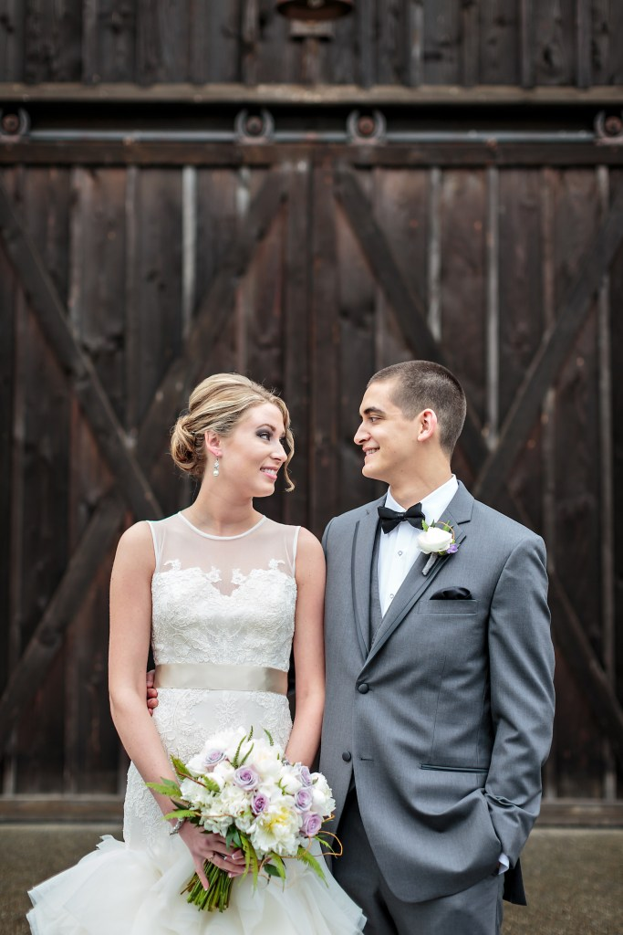 Bride and groom at Kelley Farm, Lavender and white bouquet by Jen's Blossoms