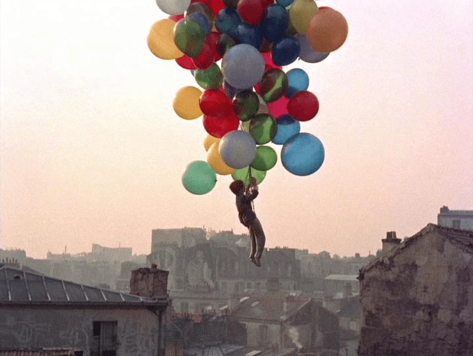 Red Balloon over city
