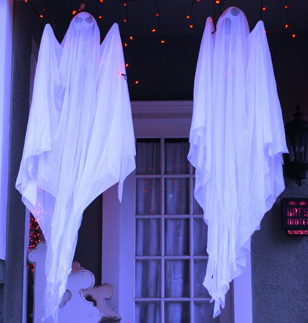 Ghosts on a porch for Halloween decorations