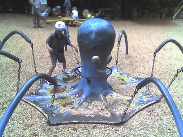 Dangerous old playground equipment octopus with chains
