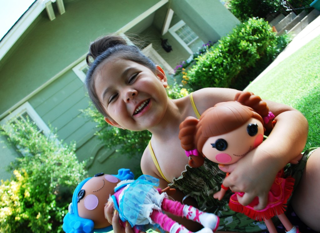 Girl with her Lalaloopsy Dolls