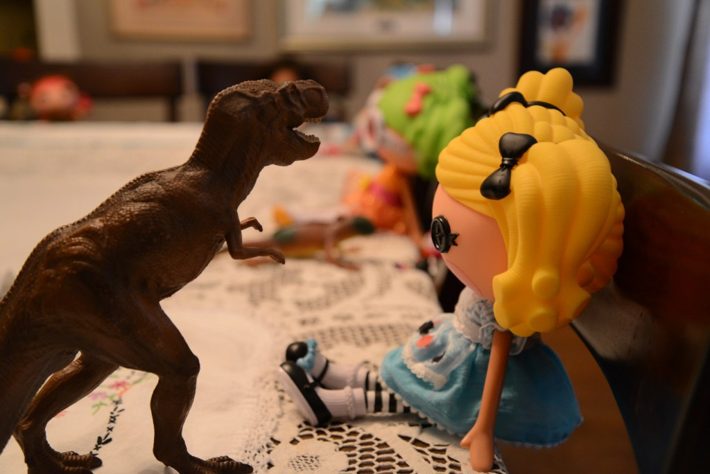 T. Rex tries to eat Alice in Lalaloopsy Land.