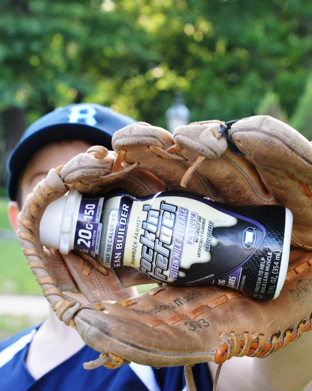 A baseball player drinks high protein drink a protein drink called Rockin Refue