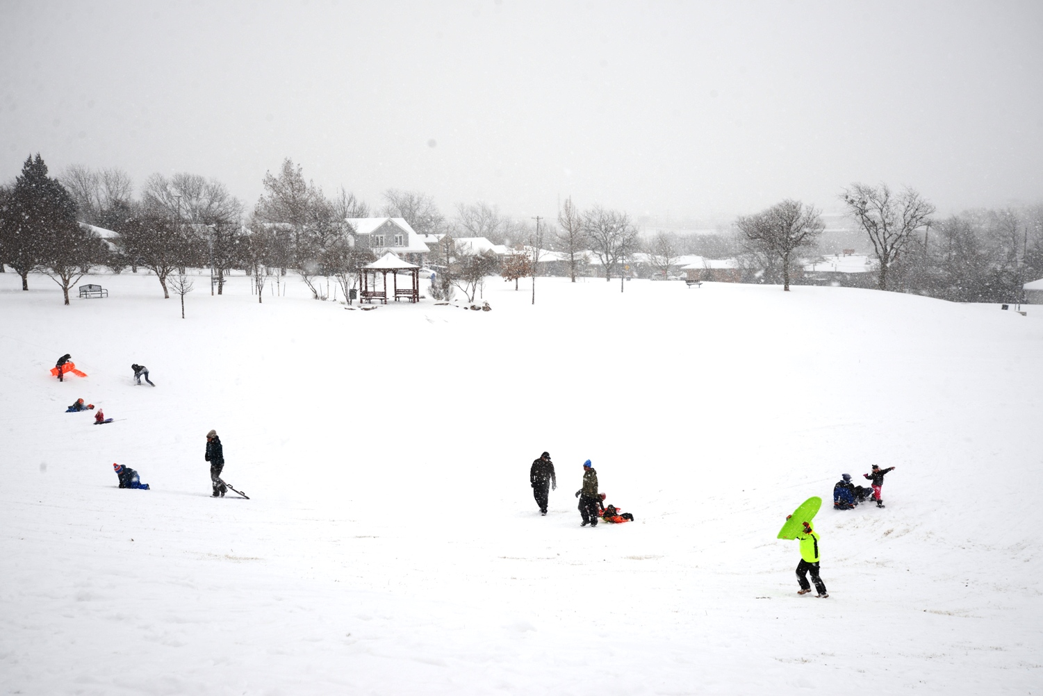 People Sledding on a snow day