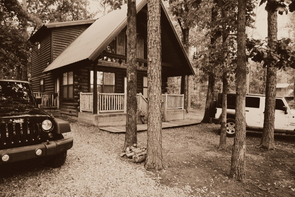 Two Jeeps and a cabin