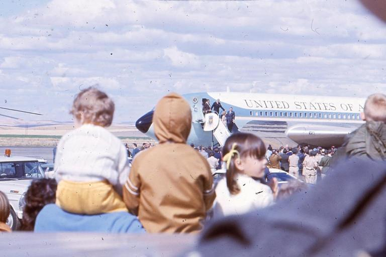 Three young children witness the arrival of President Richard Nixon and Air Force One, September 21, 1971, Walla Walla, Washington