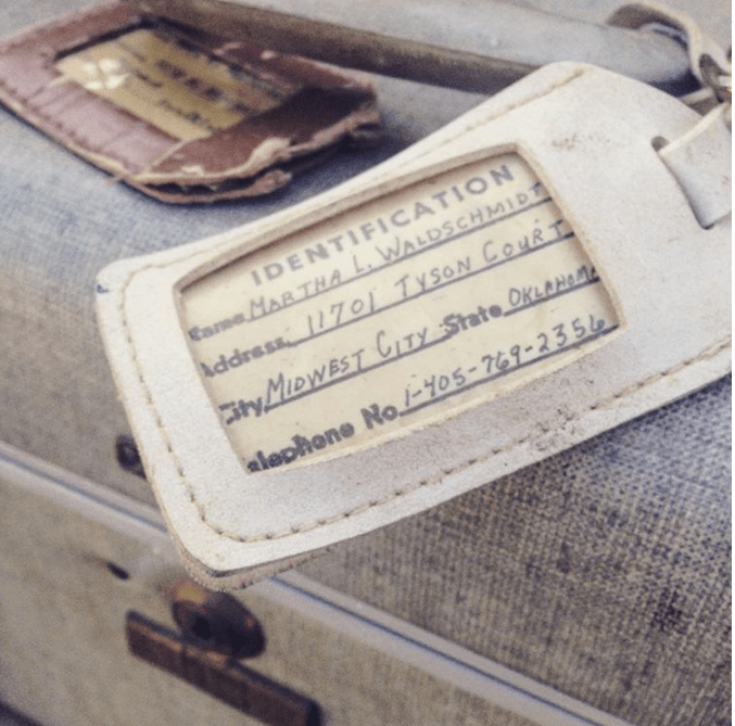 Vintage Train Case with old luggage tag