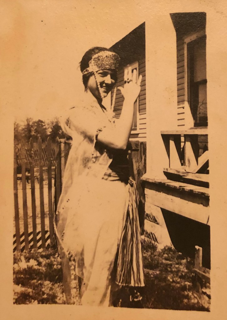 A woman dressed up as a gypsy for Halloween, 1919. Location: Texas or Oklahoma