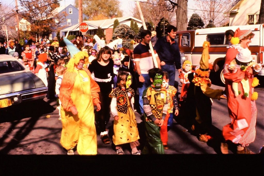 1980s Halloween Parade featuring children in flame retardant smocks and plastic masks including the Incredible Hulk.