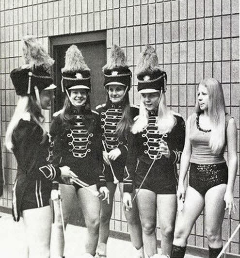 Majorettes in band jackets and shorts. This was still popular when I was in junior high and high school.