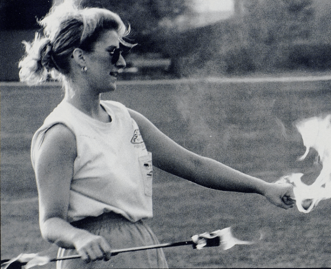 University of Kentucky majorette, Shannon Werner, prepares to practice fire baton, 1993.
