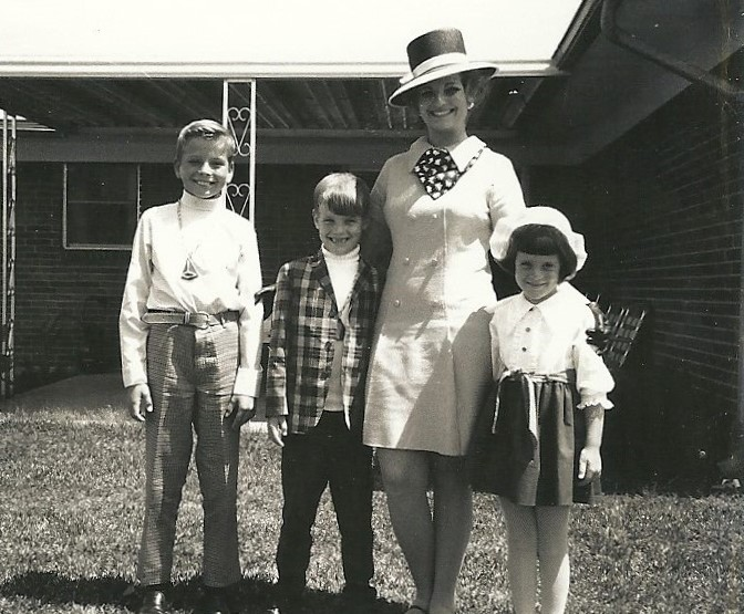 Silent Generation Mama in an awesome hat. I'm taking a wild guess that the youngest child in this picture is the earliest of the first-wave Xers, possibly born in 1961. The photo was taken in 1967.