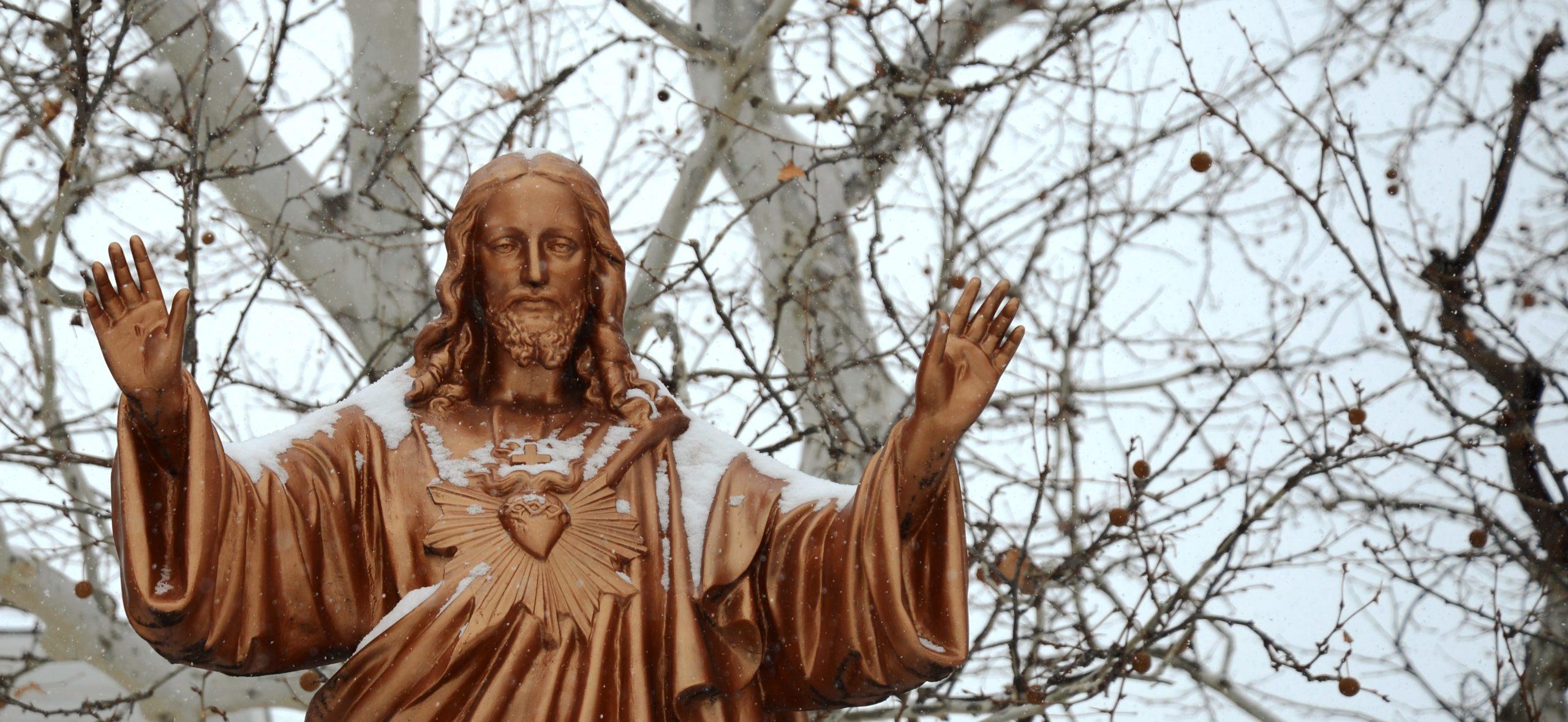 Jesus Statue in Snow