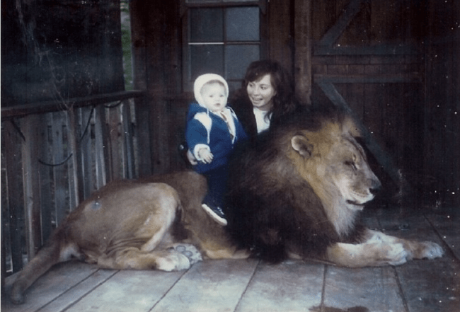 Mom and Child Get Picture with Lion
