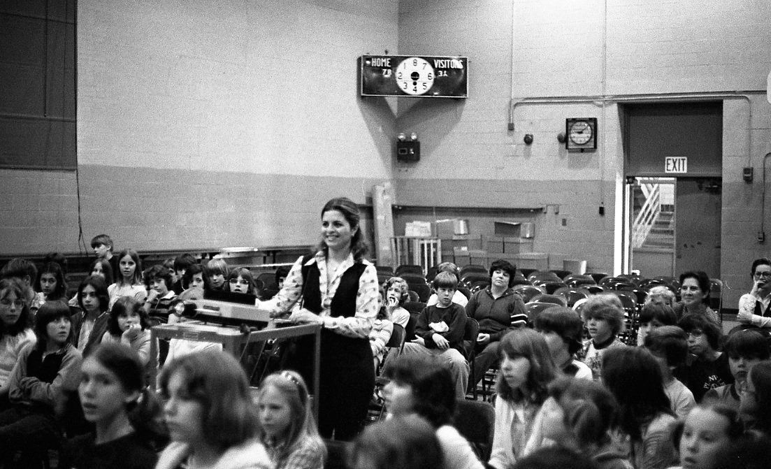 Librarian sets up classroom Films on an old school film projector in the 1970s