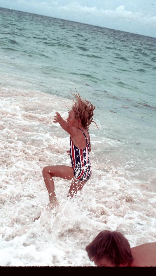 Girl Splashing in Waves on Beach 1976