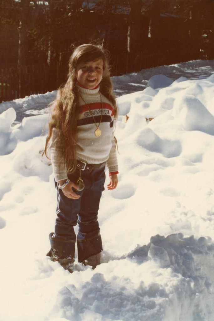 A little girl sports an Everest 78 sweater on a snowy mountain in 1978.