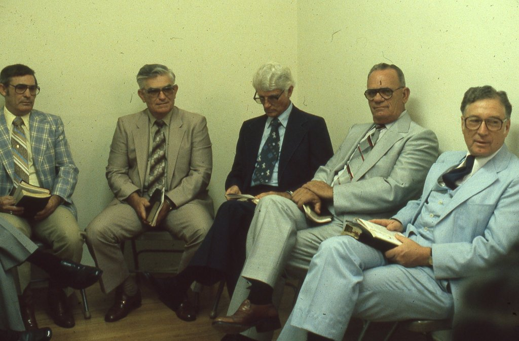 Men' wearing 1980s suits and eyeglasses, sit in a Sunday School Class, 1981