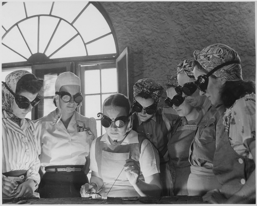 April 1942: Secretaries, housewives and waitresses learn war work.