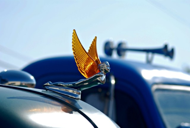 Hood Ornament Woman with Wings Flying through the air