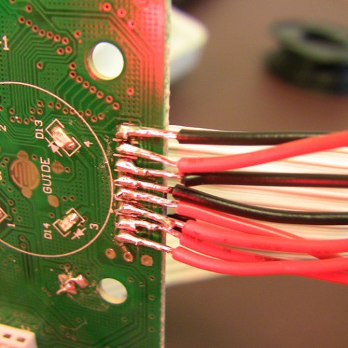 Button connection wires soldered onto existing board connections