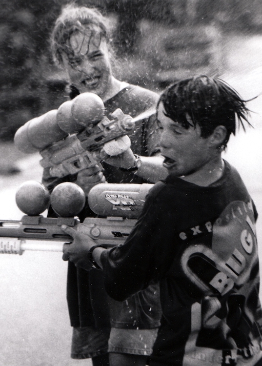 Cooling off with a water gun fight – from Jeremy Larochelle's photo portfolio.