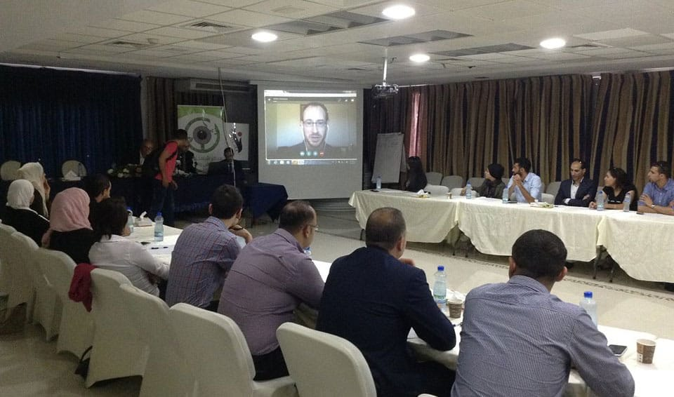 """Jeremy R. Hammond speaks via Skype on the role of the US media in the Palestine conflict at the second of a series of conferences titled """"100 Global Thinkers in Palestine"""". Ramallah, September 20, 2016. (Photo: SHAHED)"""