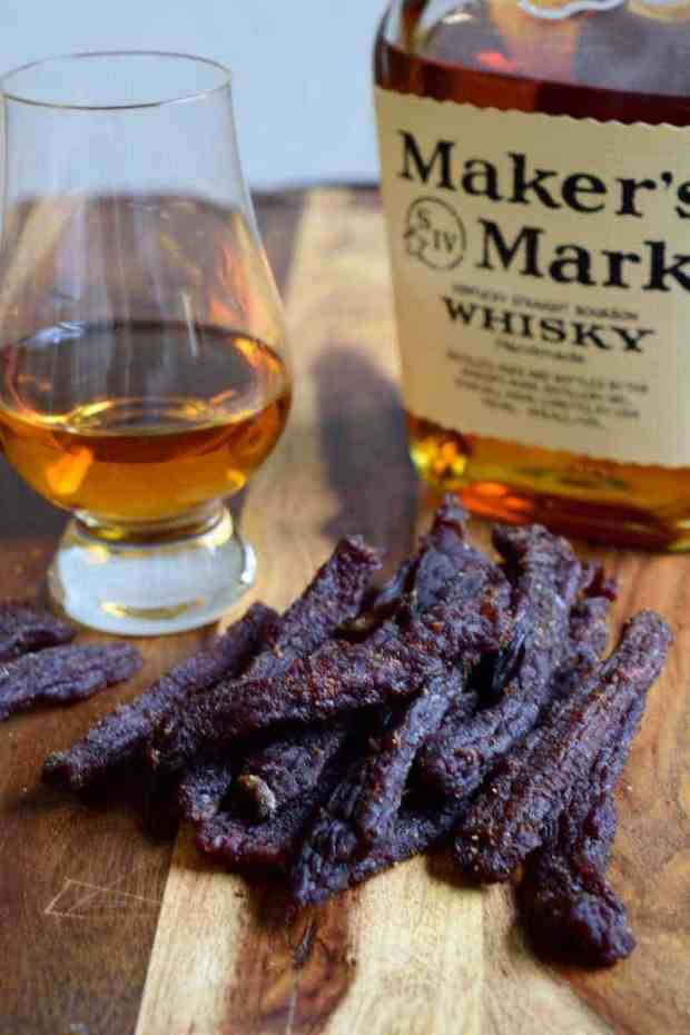 Looking for a rough and tough beef jerky recipe made for a REAL man? Good news, you just found it! Bourbon + Beef Jerky = Manly. | Jerkyholic.com