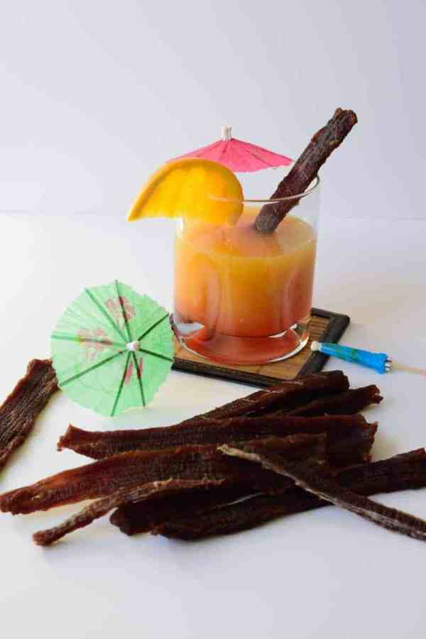 This Mai Tai Beef Jerky has all the great flavors of this tropical drink. It will take you back to a memory of you sitting by the pool or on the beach soaking up some sun and having a refreshing drink. | Jerkyholic.com