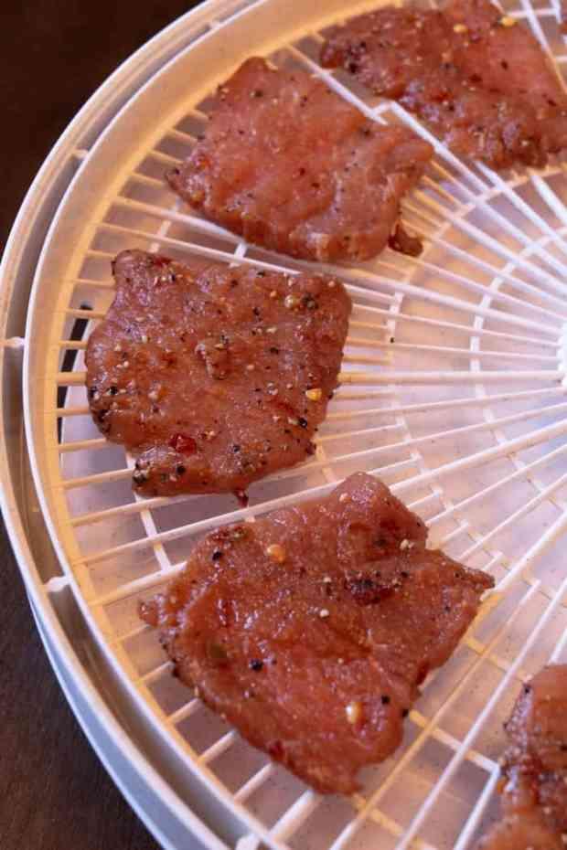 Pork jerky on dehydrator trays