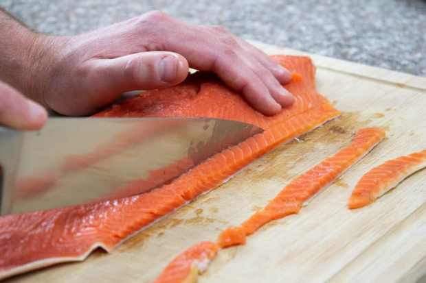 Slicing salmon fillet for salmon jerky