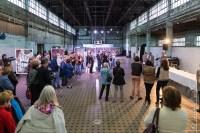 """Le vernissage de l'exposition, avec en arrière plan les photographies de Takuji SHIMMURA - lauréat catégorie """"pros"""""""