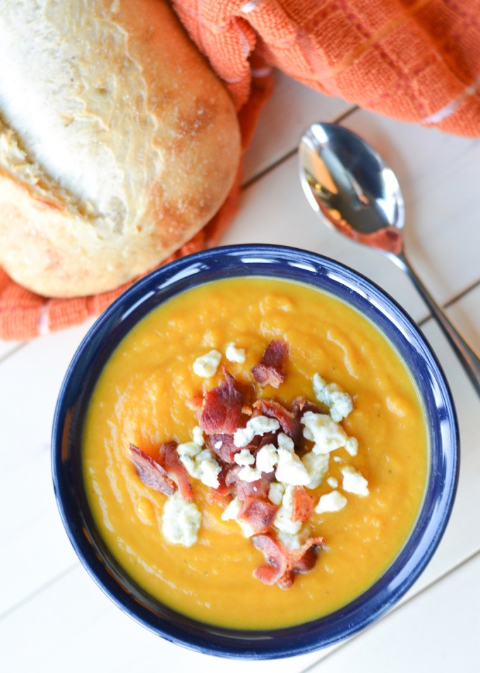 Your crock pot makes this Slow Cooker Butternut Squash Soup easy and hands-off! It's topped with salty bacon and blue cheese, a delicious contrast to the sweet, creamy soup. This is a perfect fall meal the whole family will love!