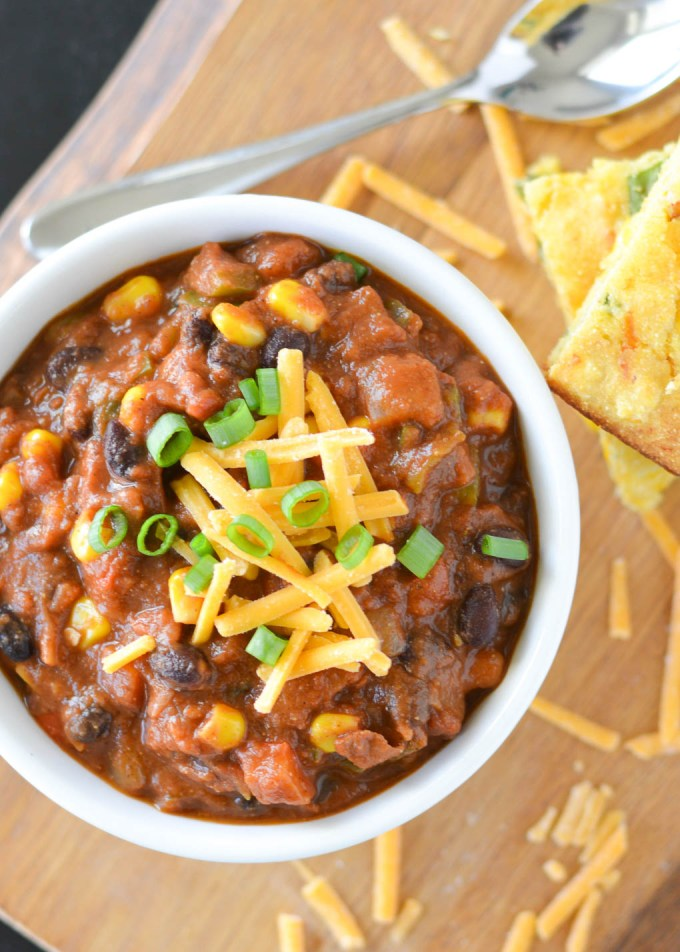 This Black Bean and Corn Chili is a great meatless meal that's ready in under 30 minutes. It's so thick and hearty, you won't miss the meat. Especially when paired with some warm baked corn bread!