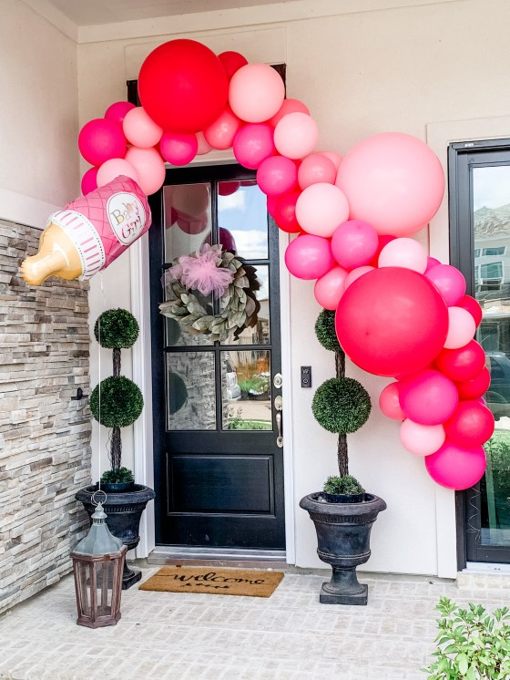 DIY Balloon Garland by popular by Houston lifestyle blog, Jessica Crum: image of a pink balloon garland hanging above a front door.