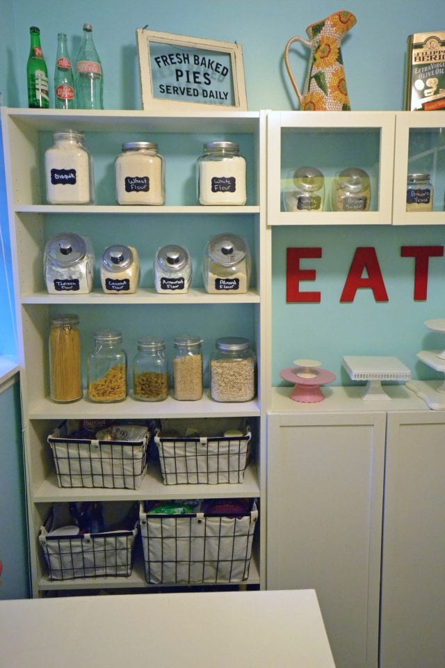 Clean, colorful, and organized—this is what walk-in pantry dreams are made of!