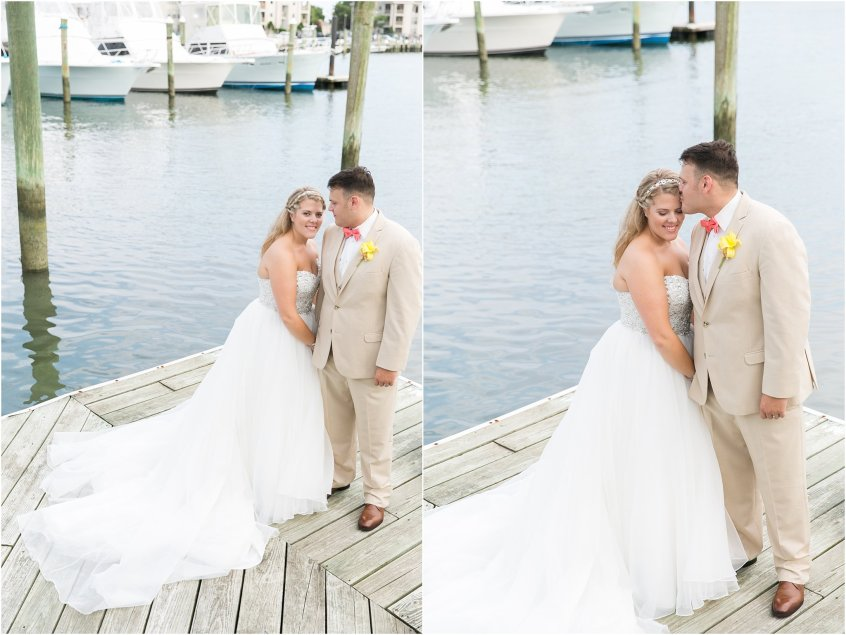 virginia beach the water table wedding day bride and groom candid portrait on the marina dock