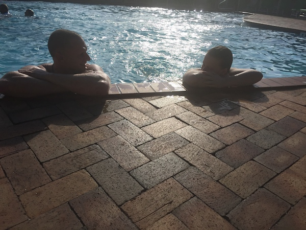 Peige and Chris taking in the sunset by the pool