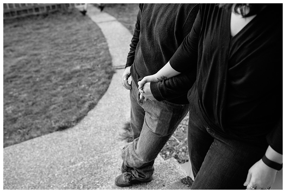 couple holding hands in black and white photo by Jessica Uhler Photography