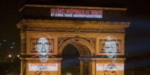 Les visages de Stéphane Taponier et Hervé Guesquière sur l'Arc de Triomphe à paris